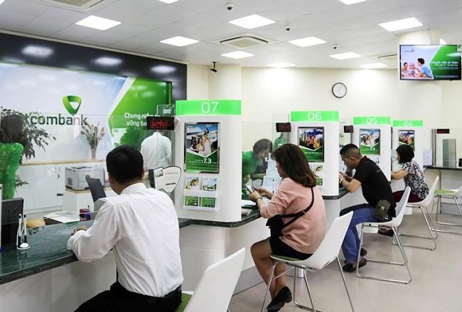 Vietcombank: Lợi nhuận tăng mạnh, nợ xấu gần đủ mua SeaBank - Ảnh 1.