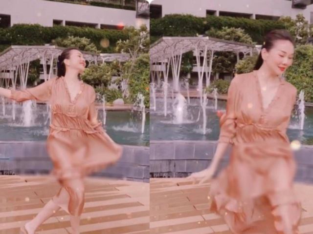 """Clip Thanh Hằng mặc váy lụa múa gợi cảm bất ngờ gặp sự cố gây ngượng """"chín mặt"""" giống Midu? - Ảnh 1."""