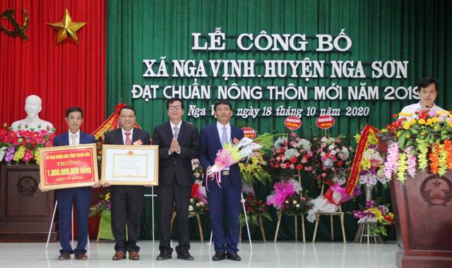 Thanh Hóa: Xã Nga Vịnh, huyện Nga Sơn đón nhận xã đạt chuẩn NTM - Ảnh 1.