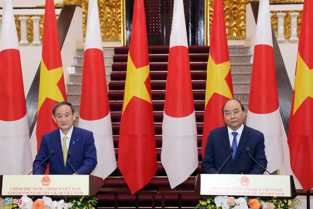 Nhìn lại một ngày hoạt động của Thủ tướng Nhật tại Hà Nội - Ảnh 4.