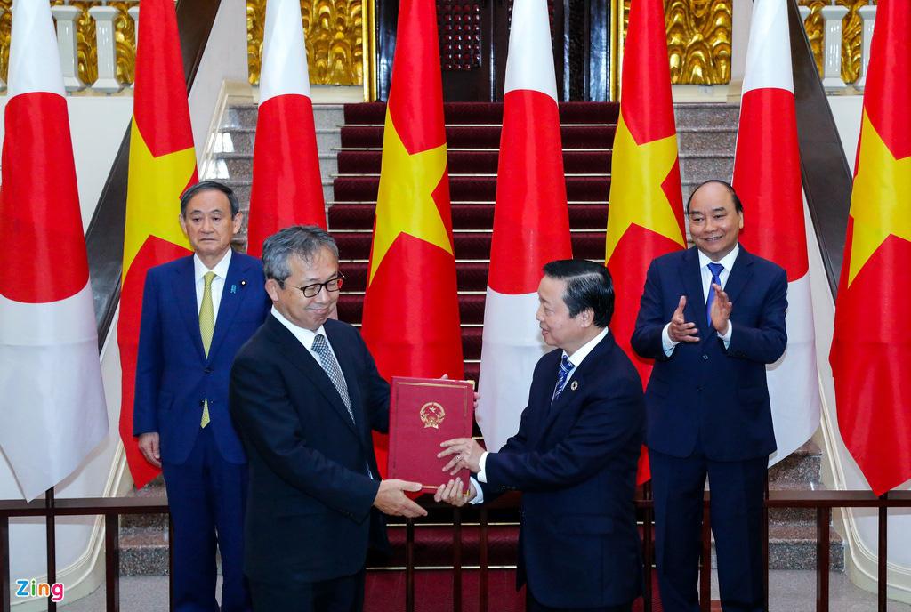 Nhìn lại một ngày hoạt động của Thủ tướng Nhật tại Hà Nội - Ảnh 5.