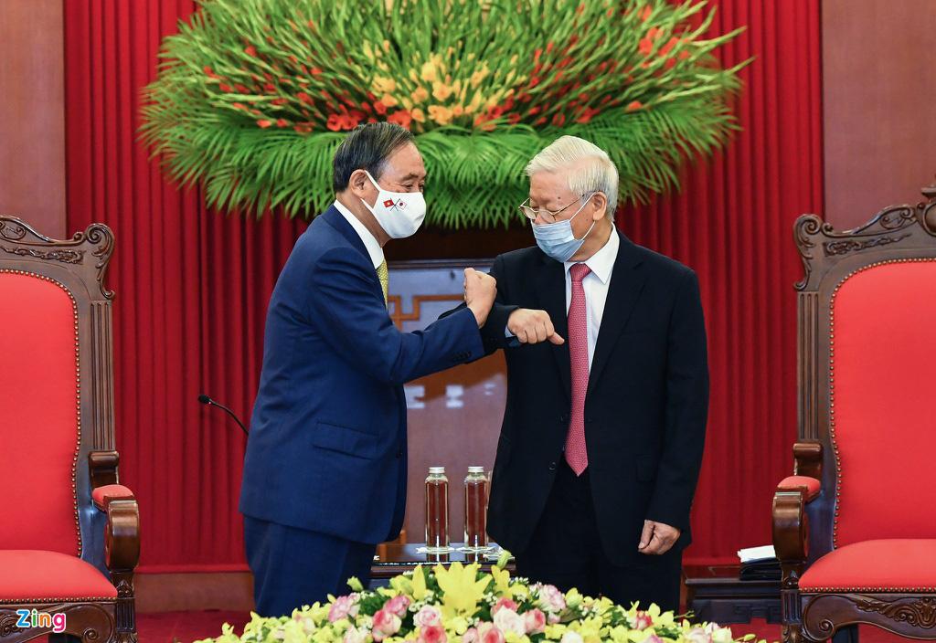 Nhìn lại một ngày hoạt động của Thủ tướng Nhật tại Hà Nội - Ảnh 6.