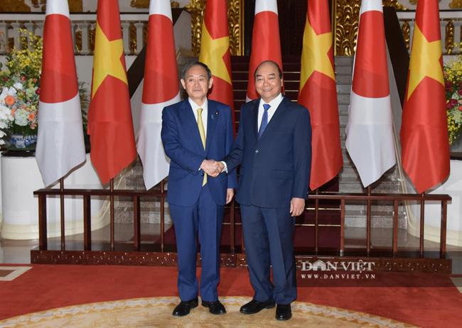 Nhìn lại những hoạt động của Thủ tướng Nhật Bản Suga Yoshihide trong 2 ngày tại Việt Nam - Ảnh 3.