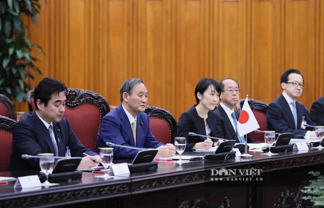 Nhìn lại những hoạt động của Thủ tướng Nhật Bản Suga Yoshihide trong 2 ngày tại Việt Nam - Ảnh 4.