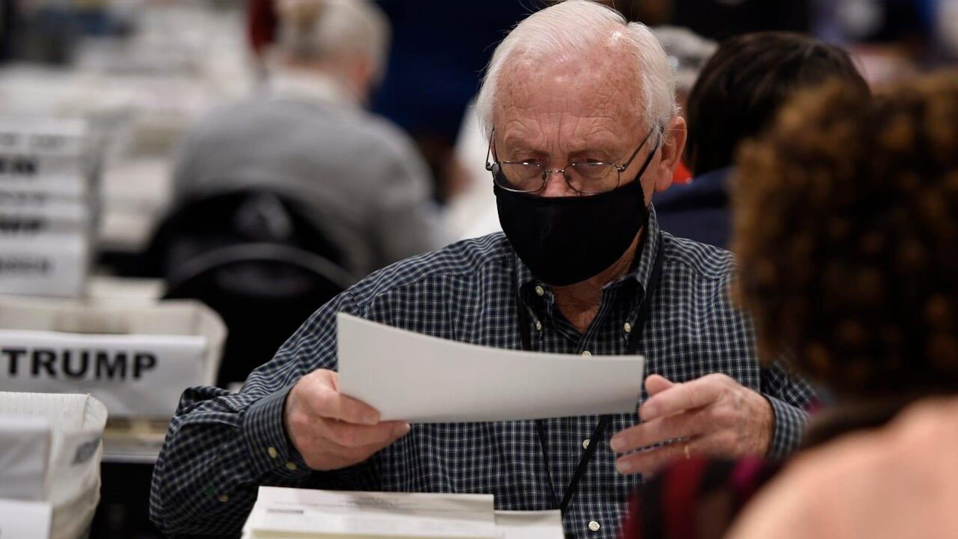 Bầu cử Mỹ: Phát hiện thêm 3.000 phiếu bầu bị bỏ sót ở Georgia, điều gì đang xảy ra? - Ảnh 1.