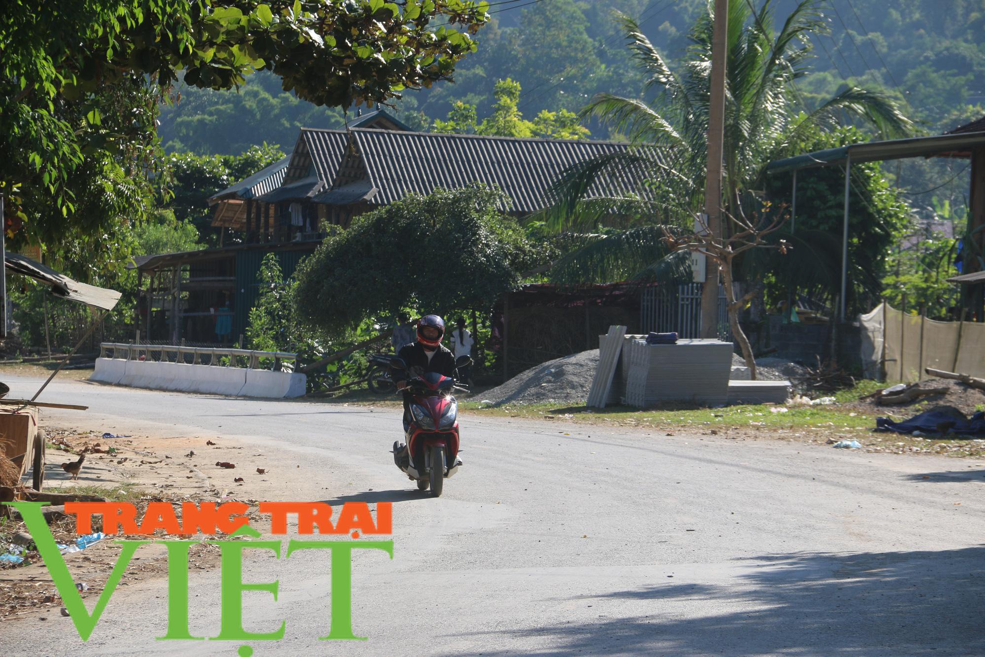 Người dân Quỳnh Nhai góp hàng nghìn ngày công, hiến đất xây dựng nông thôn mới - Ảnh 7.