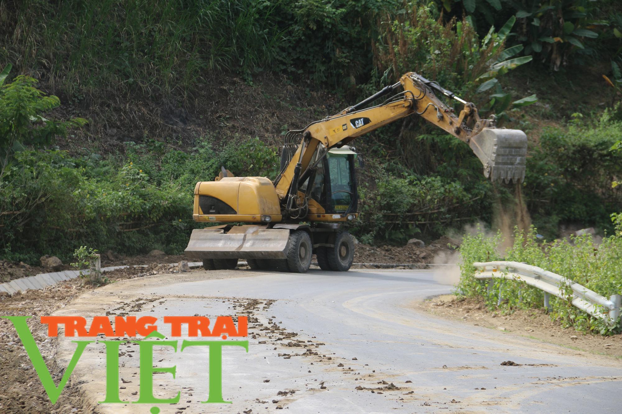 Người dân Quỳnh Nhai góp hàng nghìn ngày công, hiến đất xây dựng nông thôn mới - Ảnh 3.