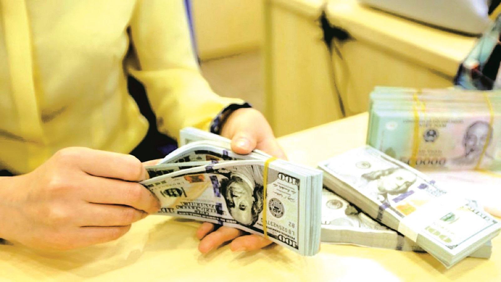 Vay 5 vạn tỷ USD, Vingroup của tỷ phú Phạm Nhật Vượng hưởng lợi khi VND lên giá? - Ảnh 1.