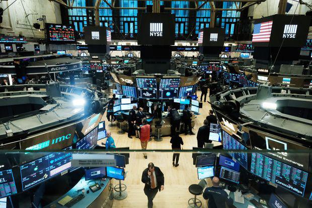 Dow Jones giảm 170 điểm sau phiên phá mốc 30.000 điểm - Ảnh 1.