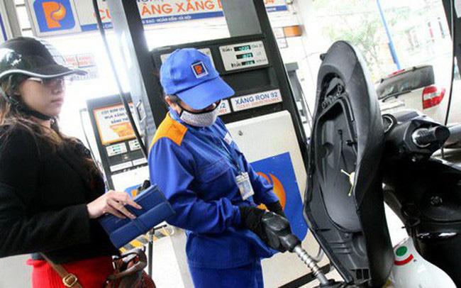 Giá xăng giảm 613 đồng/lít từ 15h ngày 13/4 - Ảnh 1.