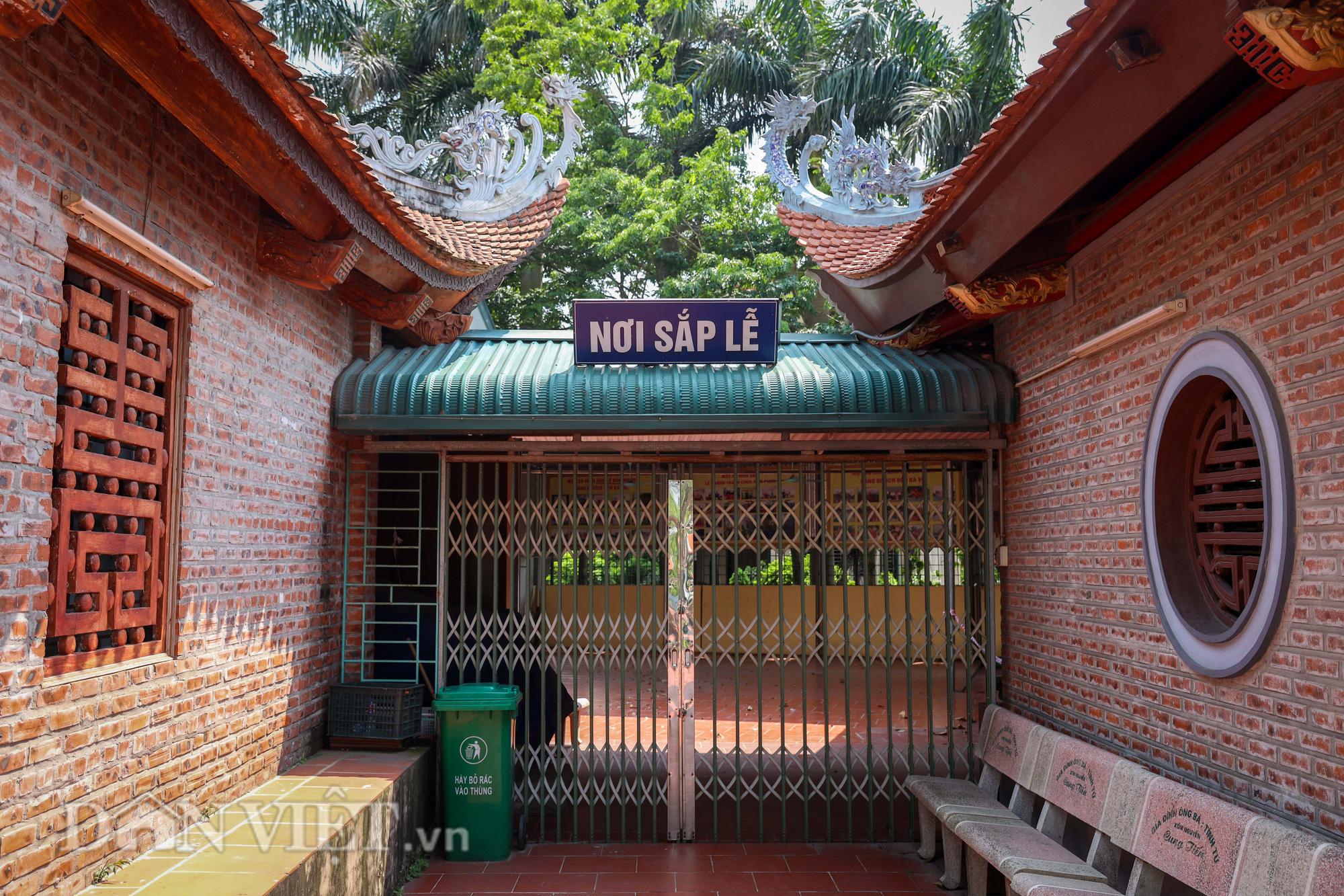 Đền Ba Voi ở Hà Nội bị đóng cửa vì sạt lở bờ sông - Ảnh 9.