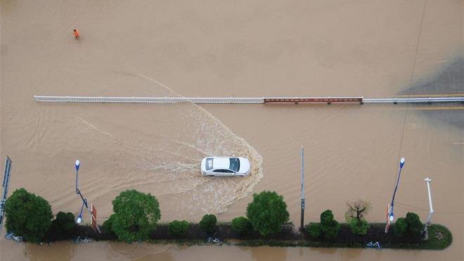 Ông Tập lên tiếng về mưa lũ lịch sử tác động đến 13,7 triệu ở người Trung Quốc - Ảnh 1.