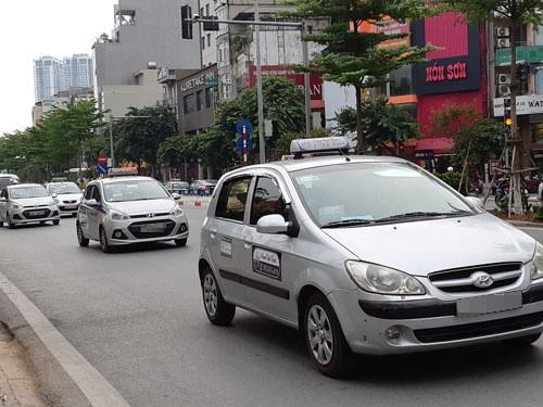 Chấm dứt tranh cãi taxi và xe công nghệ - Ảnh 1.