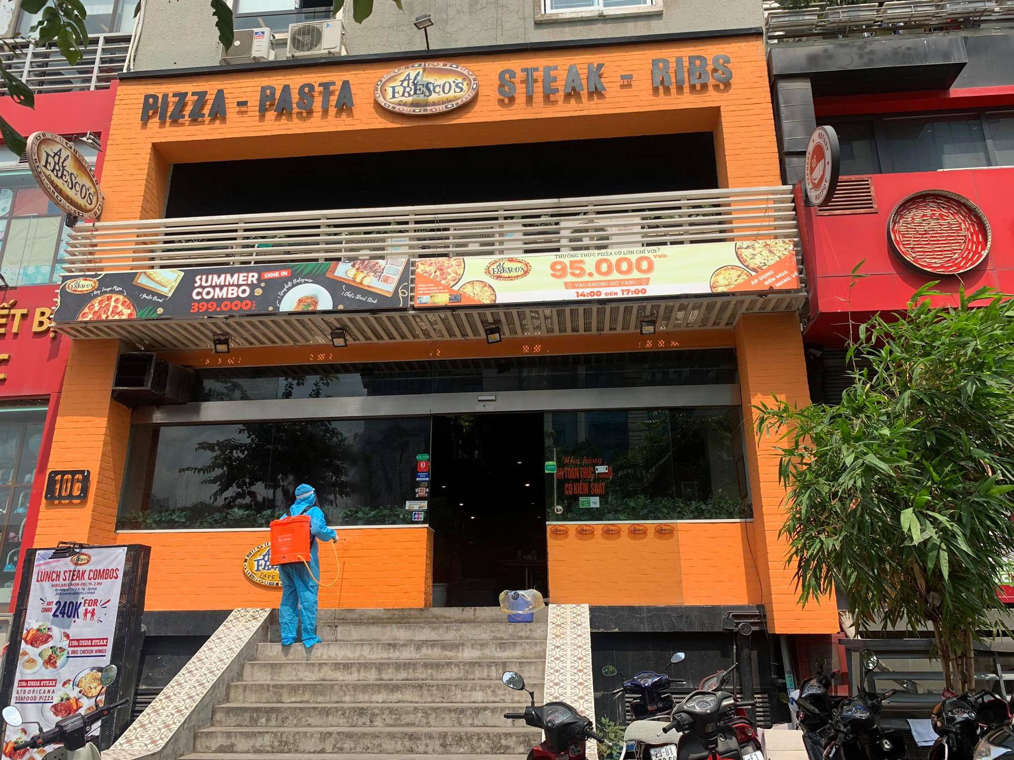 -19 tại Hà Nội: Phong toả và khử trùng quán pizza trên phố Trần Thái Tông - Ảnh 1.