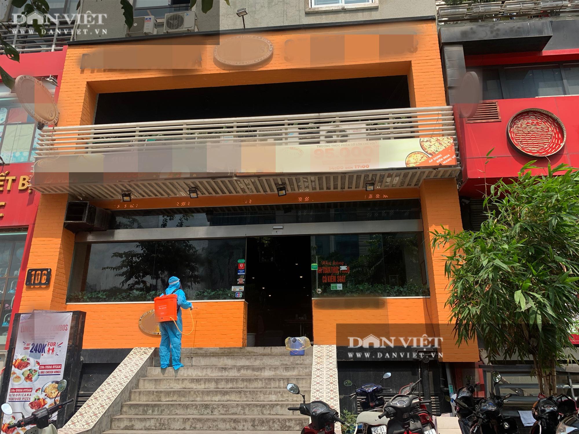Một bệnh nhân nghi nhiễm Covid-19 tại Hà Nội: Phong toả và khử trùng quán pizza trên phố Trần Thái Tông - Ảnh 1.