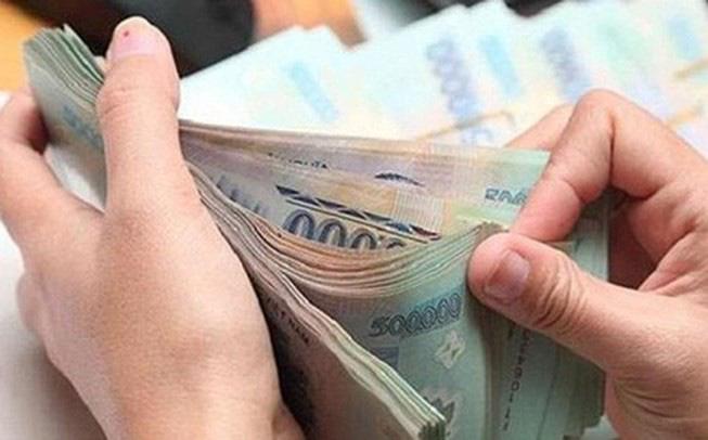 Chậm trả lương, trả lương không đủ doanh nghiệp có thể bị phạt tới 100 triệu đồng - Ảnh 1.
