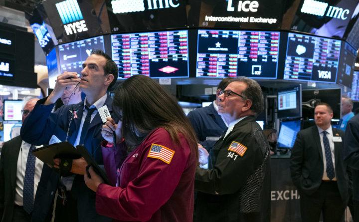 Chứng khoán Mỹ giao dịch hỗn hợp khi FED tuyên bố duy trì lãi suất thấp - Ảnh 1.
