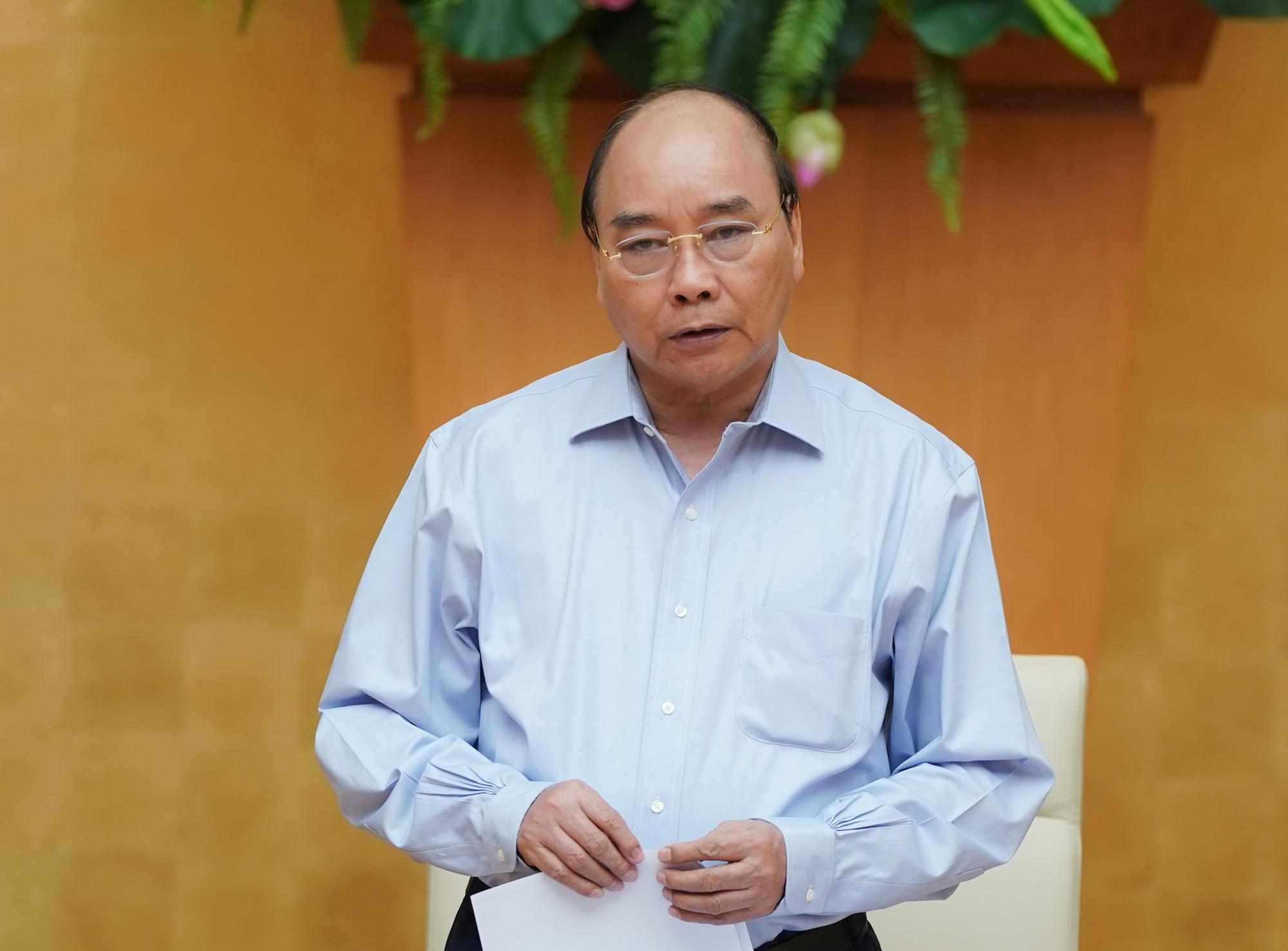 Thủ tướng hoan nghênh TP.HCM và Hà Nội xử phạt nghiêm cá nhân không đeo khẩu trang nơi đông người - Ảnh 1.