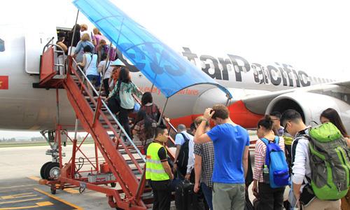 Vắng khách thừa ghế, giá vé máy bay lại rẻ bèo - Ảnh 1.