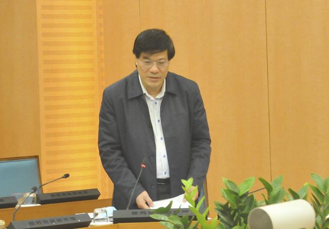 Vụ nâng khống giá máy xét nghiệm Covid-19: Đề nghị truy tố Giám đốc CDC Hà Nội Nguyễn Nhật Cảm và 9 bị can - Ảnh 1.