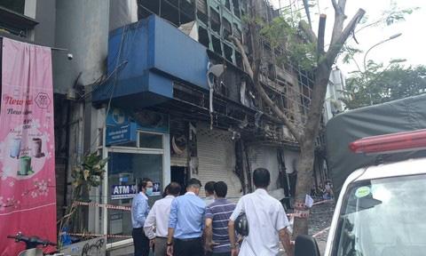 TPHCM: Bắt thủ phạm gây cháy chi nhánh ngân hàng Eximbank - Ảnh 1.