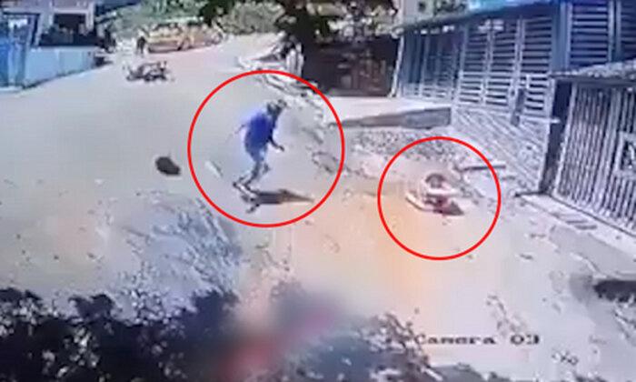Video: Thanh niên vứt xe máy giữa đường, lao ra cứu em bé đang trôi xe - Ảnh 2.