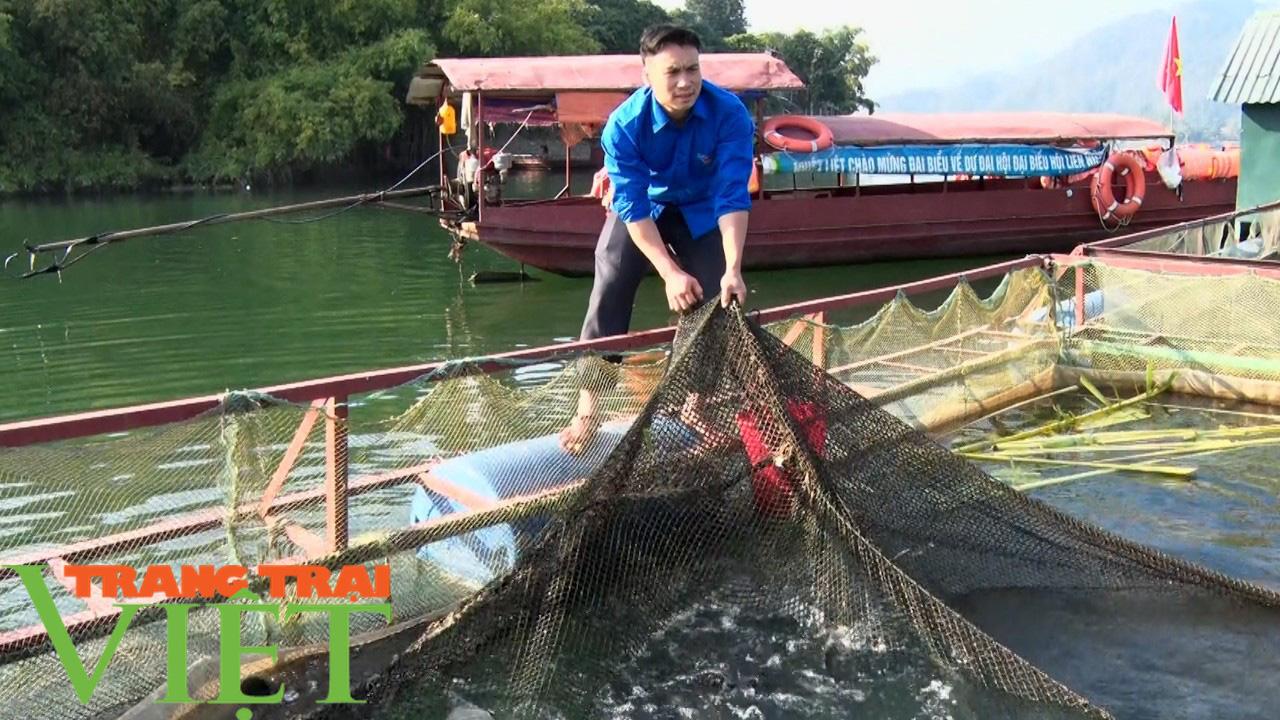 Bỏ túi trên 160 triệu đồng từ nuôi cá lồng trên lòng hồ sông Đà  - Ảnh 1.