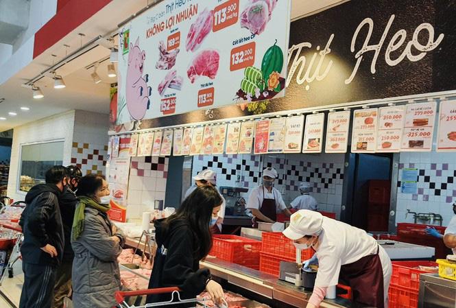 Giá thịt lợn siêu thị rẻ hơn chợ truyền thống - Ảnh 1.
