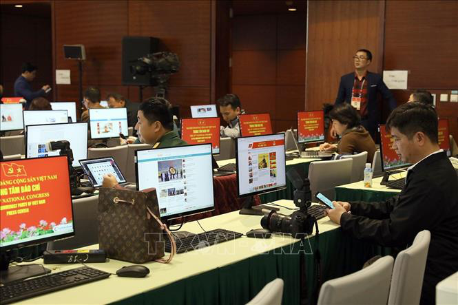 Gần 500 phóng viên, biên tập viên các cơ quan báo chí trực tiếp đưa tin Đại hội XIII của Đảng - Ảnh 2.