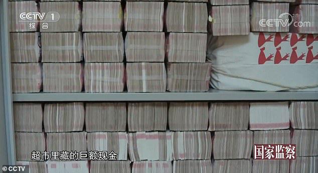 Cận cảnh nơi quan tham Trung Quốc giấu 2 tấn tiền nhận hối lộ - Ảnh 3.