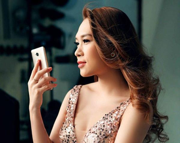 Ca sĩ Mỹ Tâm đại diện cho điện thoại Huawei và cái kết bất ngờ - Ảnh 3.
