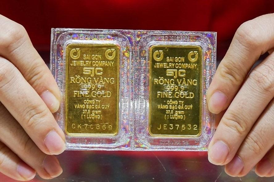 Giá vàng hôm nay 8/3: Giảm xuống mức thấp nhất trong 9 tháng - Ảnh 2.