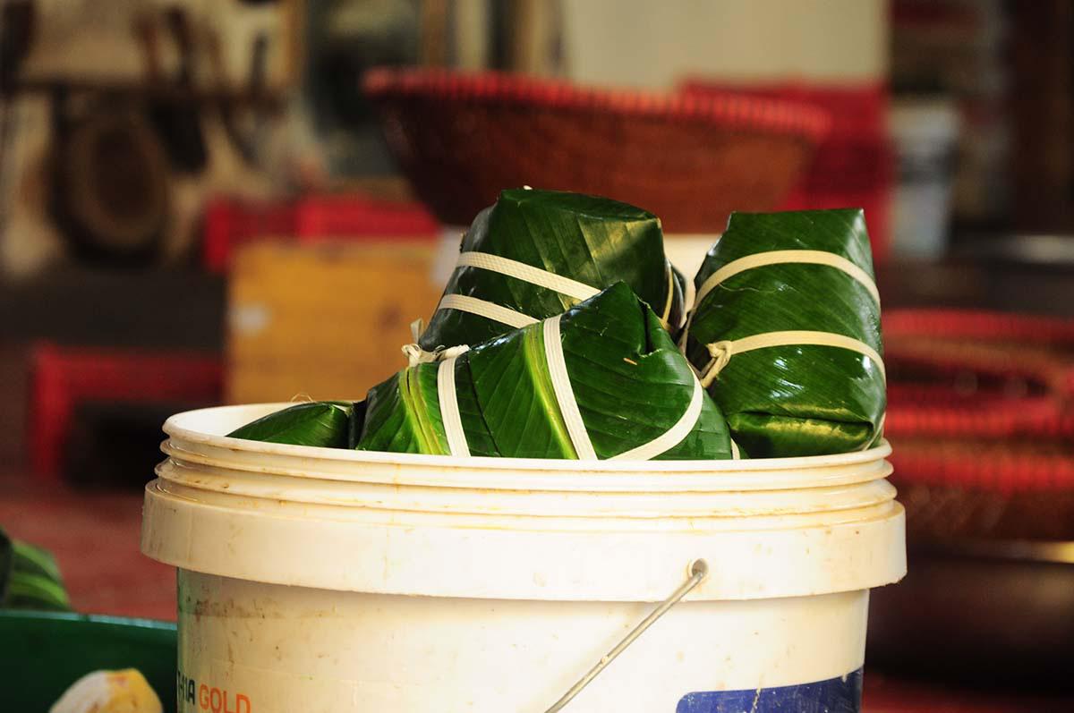Bánh chưng Tranh Khúc, ngày gói 10.000 chiếc, thu tiền trăm triệu - Ảnh 11.