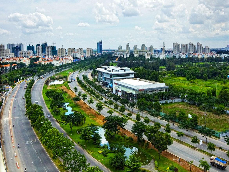 Sắp lên quận, giá đất Bình Chánh vọt lên 140 triệu đồng/m2 - Ảnh 1.