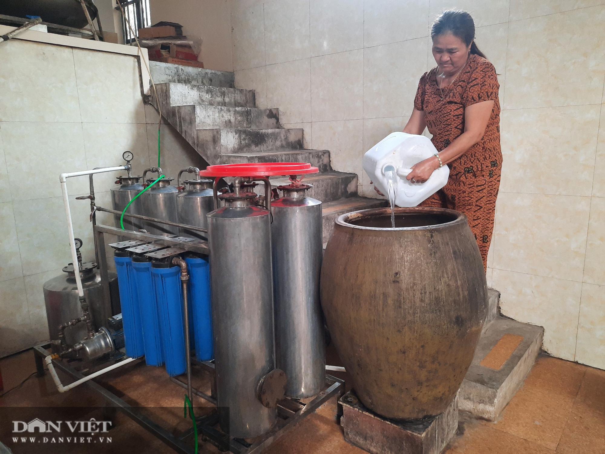 Ninh Bình: Nấu gạo cho ra thứ nước trắng trong nổi tiếng trong ngoài nước - Ảnh 2.