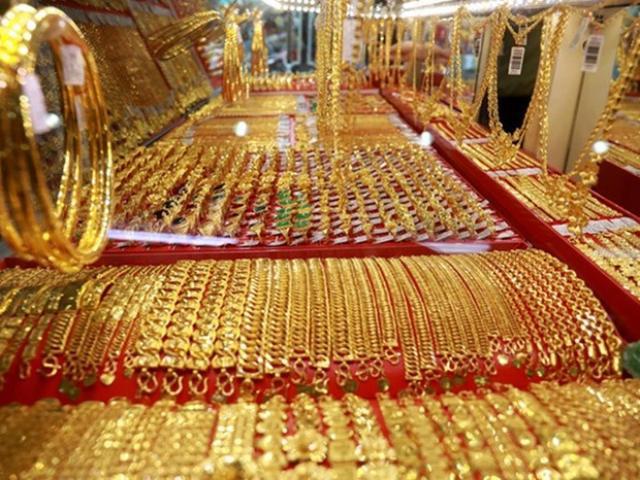 Giá vàng hôm nay 12/4: Vàng thế giới quẩn quanh mức 49 triệu đồng/lượng - Ảnh 1.