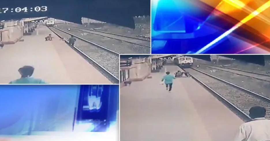 """Chạy đua với tàu, nhân viên đường sắt cứu em bé thoát khỏi """"tử thần"""" - Ảnh 1."""