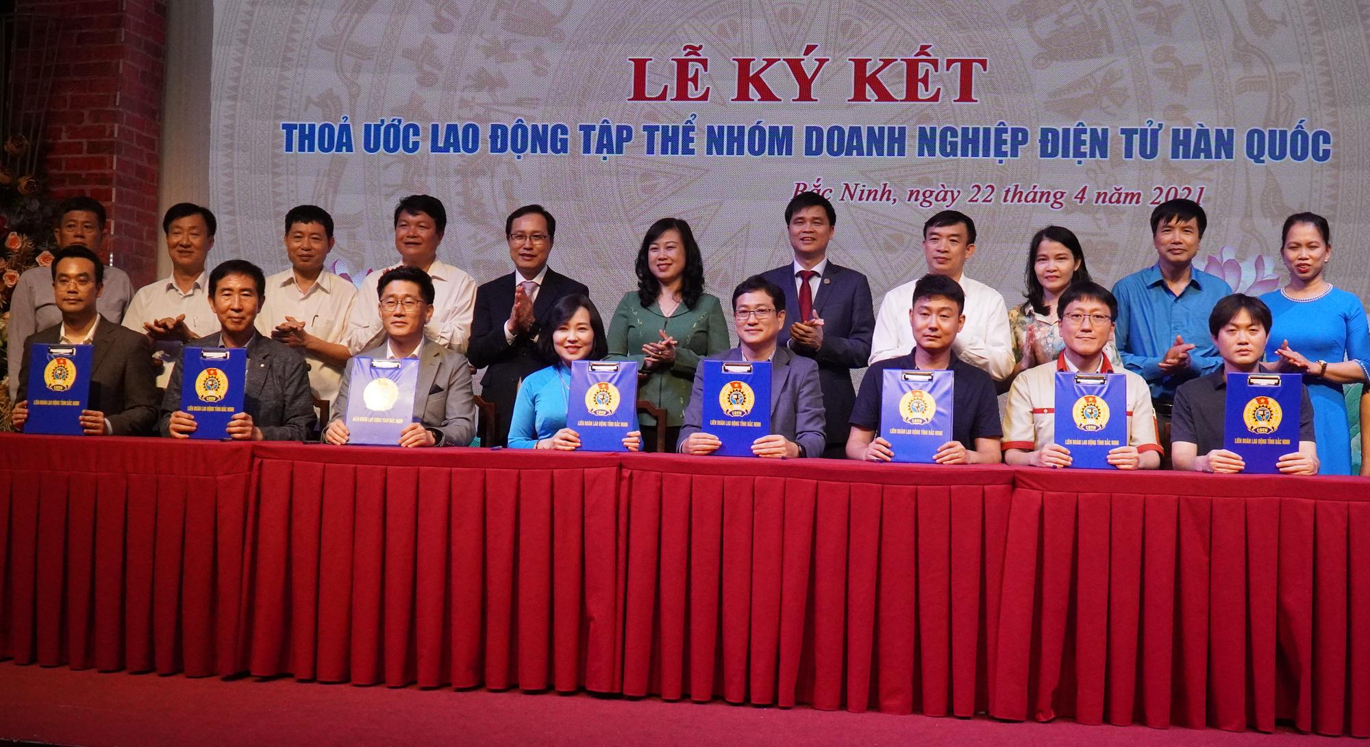 Bắc Ninh: 7 doanh nghiệp điện tử Hàn Quốc với gần 80 ngàn lao động ký kết thỏa ước lao động tập thể - Ảnh 1.