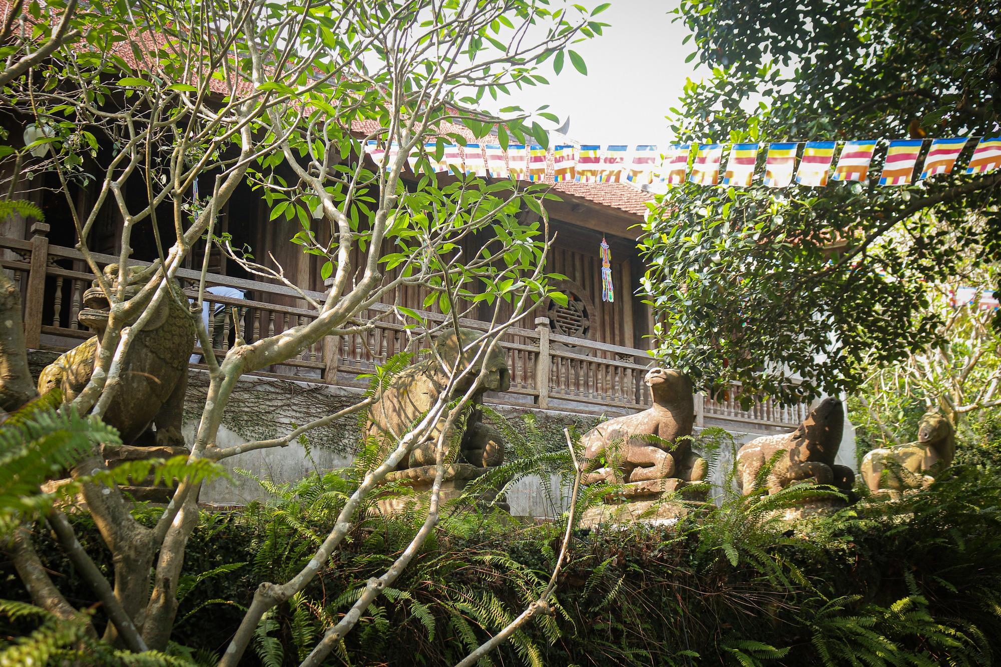 Bất ngờ ý nghĩa thực sự của bộ tượng linh thú nghìn tuổi ở chùa Phật Tích - Ảnh 1.