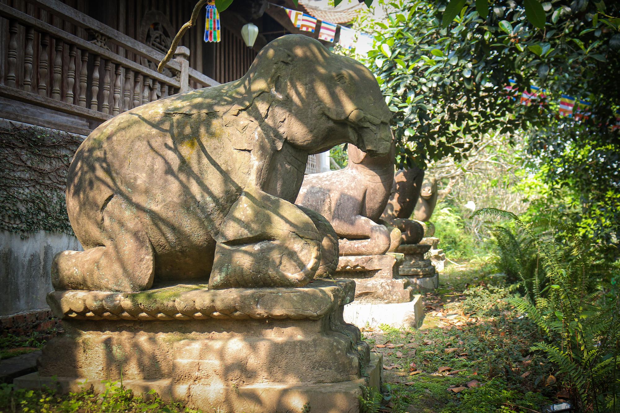 Bất ngờ ý nghĩa thực sự của bộ tượng linh thú nghìn tuổi ở chùa Phật Tích - Ảnh 8.