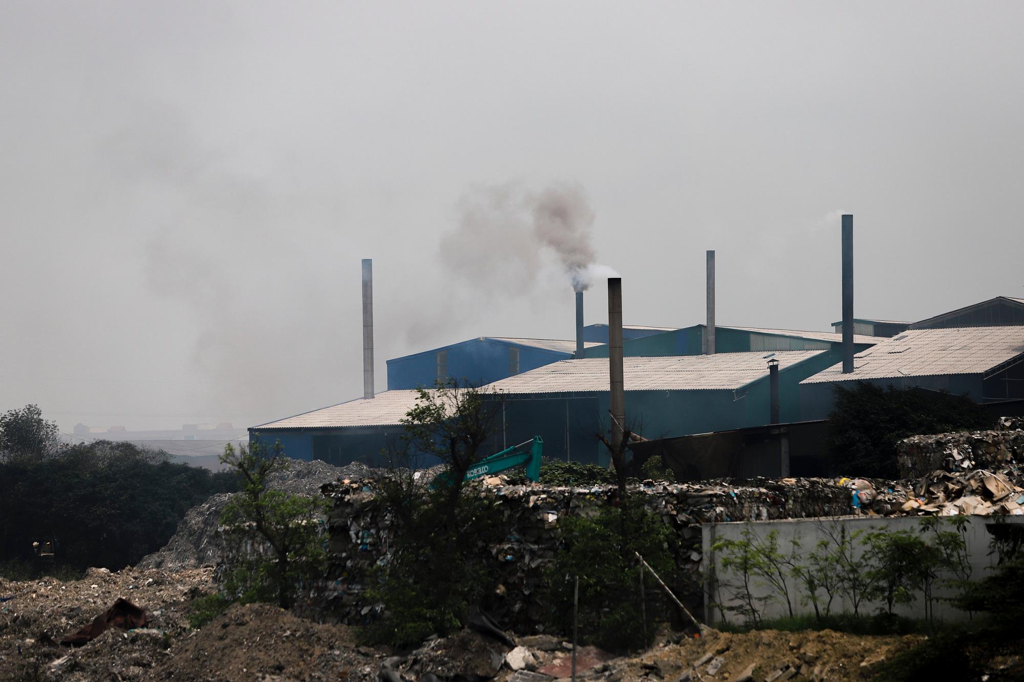 Bắc Ninh: Xử lý hình sự các trường hợp chống đối, gây ô nhiễm môi trường kinh hoàng ở làng giấy Phong Khê - Ảnh 2.