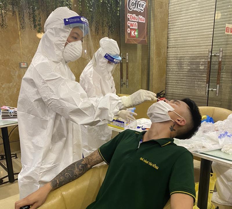 Hà Nội: Thống nhất kế hoạch triển khai tiêm vacxin phòng Covid -19 - Ảnh 1.