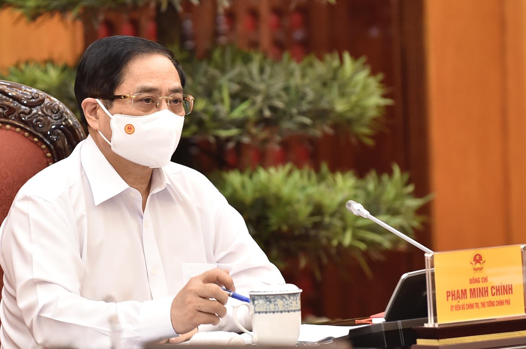 Thủ tướng Phạm Minh Chính: Mầm bệnh xuất phát từ bên ngoài, cho thấy những sơ hở trong kiểm soát, quản lý nhập cảnh - Ảnh 1.