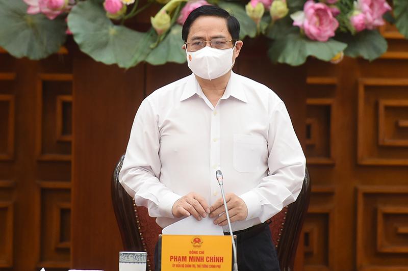 Thủ tướng Phạm Minh Chính: Mua vắc-xin phòng Covid-19 là cần thiết, cấp bách  - Ảnh 1.