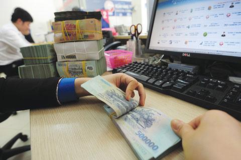 Bộ Nội vụ chủ trì xây dựng chế độ tiền lương mới trình Bộ Chính trị, Quốc hội, Chính phủ - Ảnh 1.