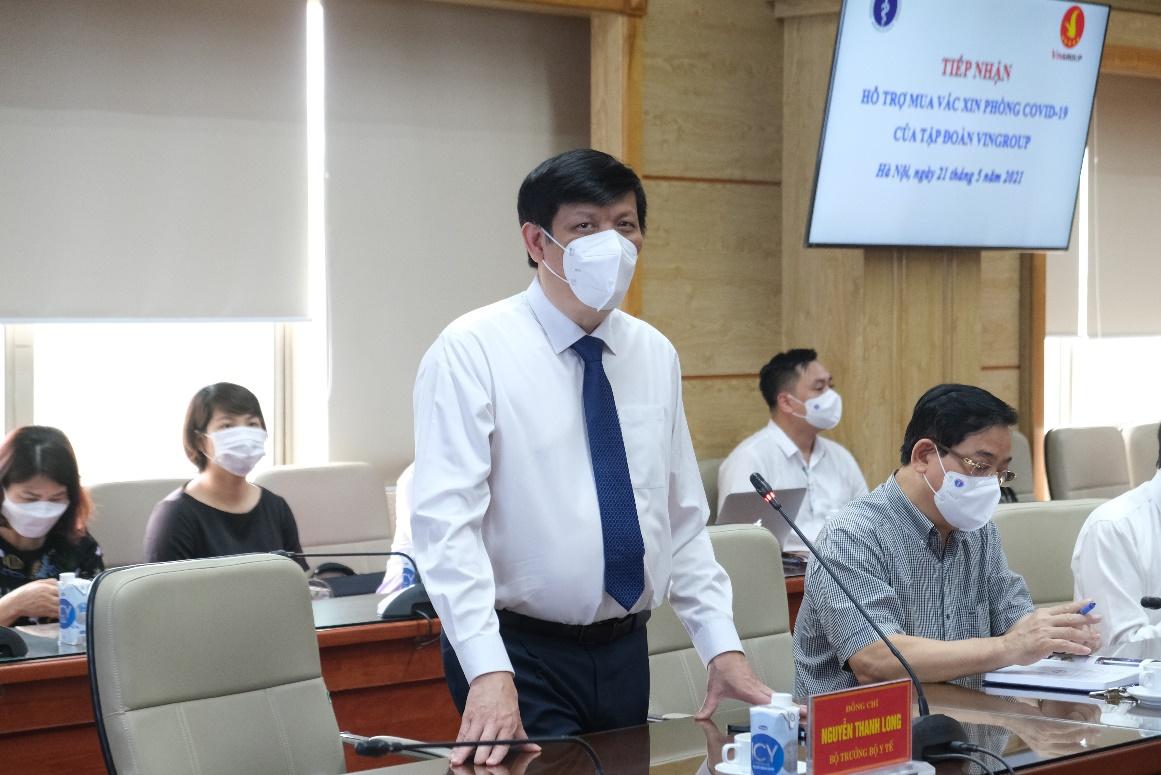 Vietcombank trao 25 tỷ đồng hỗ trợ Bộ Y Tế mua vắc xin phòng Covid-19 - Ảnh 2.