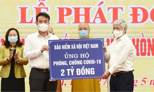 BHXH Việt Nam ủng hộ 2 tỷ đồng để chung tay đẩy lùi dịch bệnh Covid-19 - Ảnh 2.