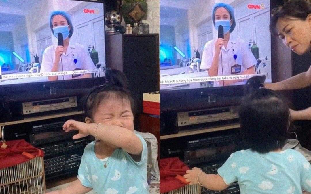 Nghẹn lòng hình ảnh bé gái khóc òa khi thấy mẹ trên tivi, bận chống dịch Covid-19 không về