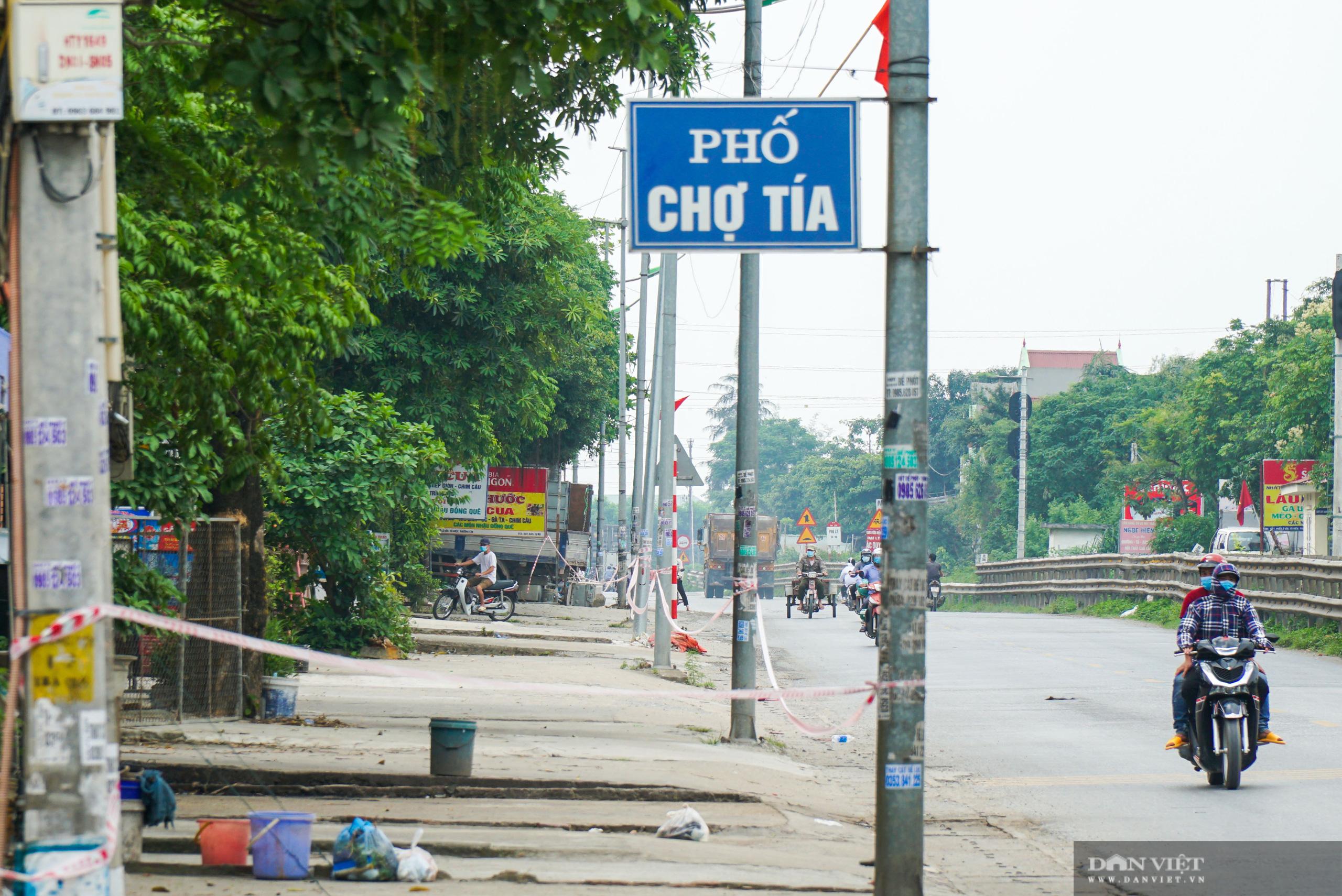 Hàng trăm hộ dân dọc quốc lộ 1A bị chằng dây phong tỏa vì dịch Covid-19 - Ảnh 1.