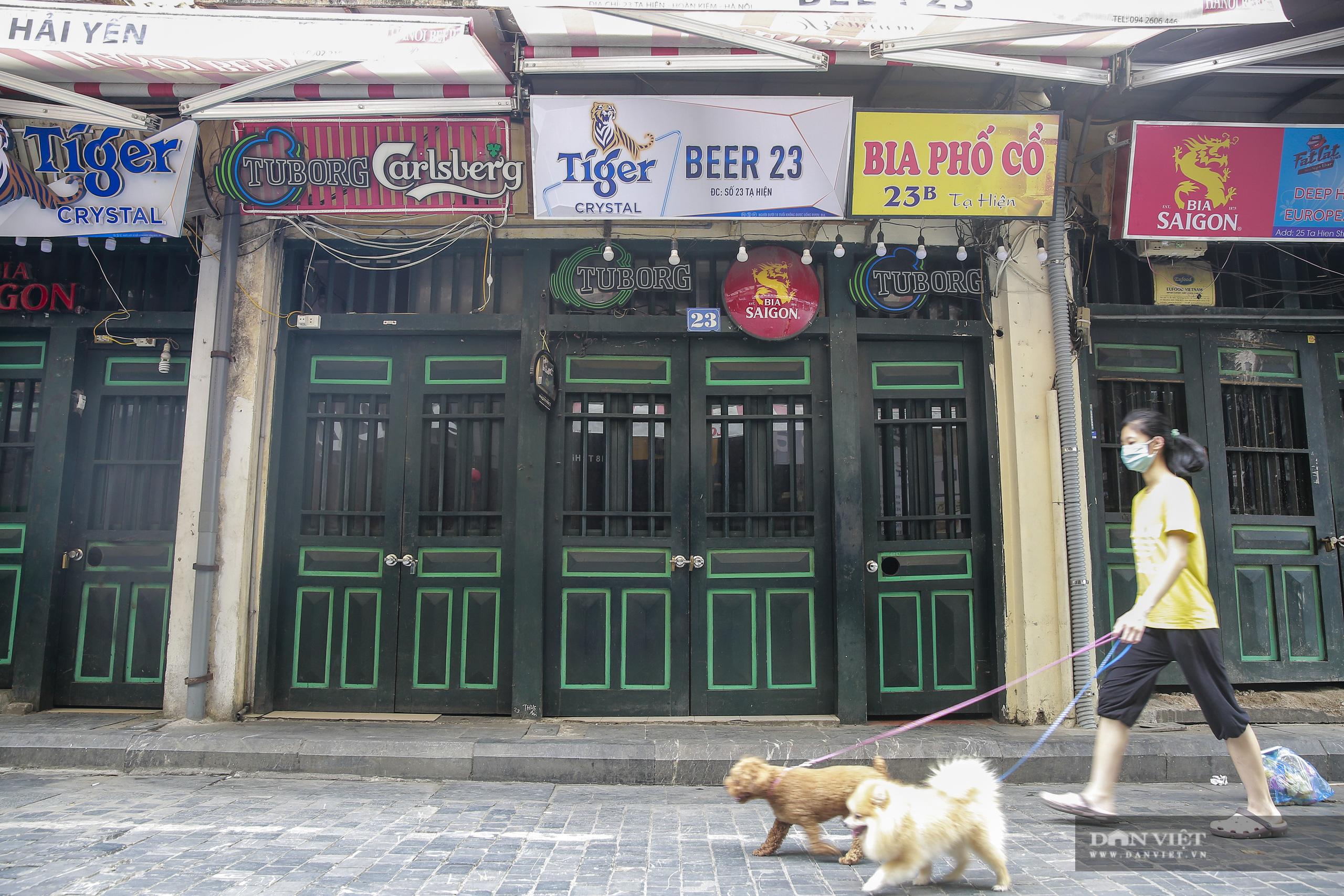 """Những phố ẩm thực """"không ngủ"""" tại Hà Nội đóng cửa hàng loạt vì Covid-19 - Ảnh 2."""